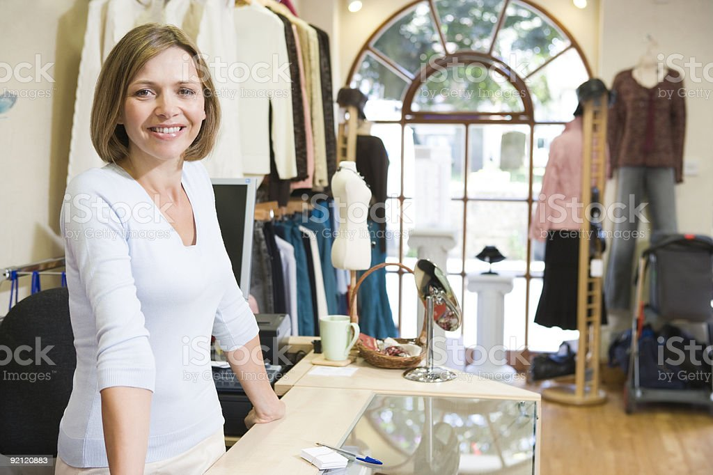 Woman at clothing store smiling stock photo