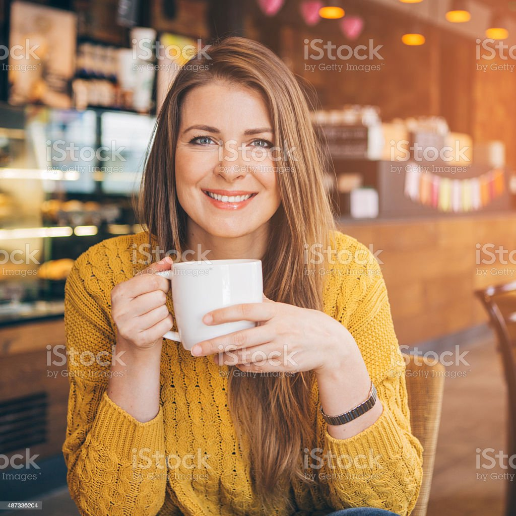 Woman at coffee shop. stock photo