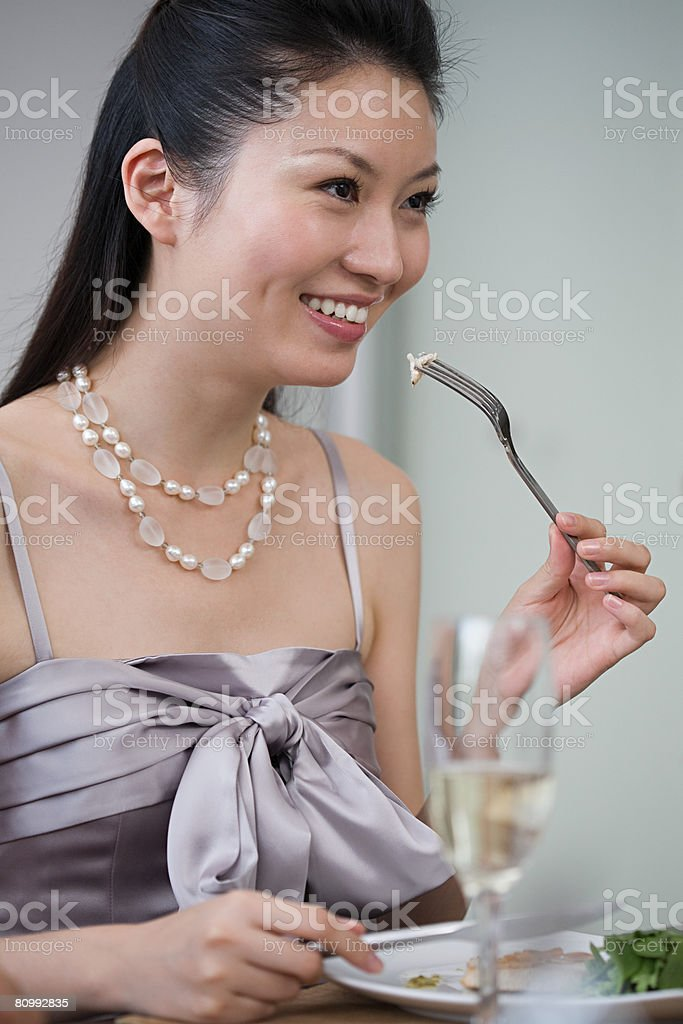 Woman at dinner party royalty-free stock photo