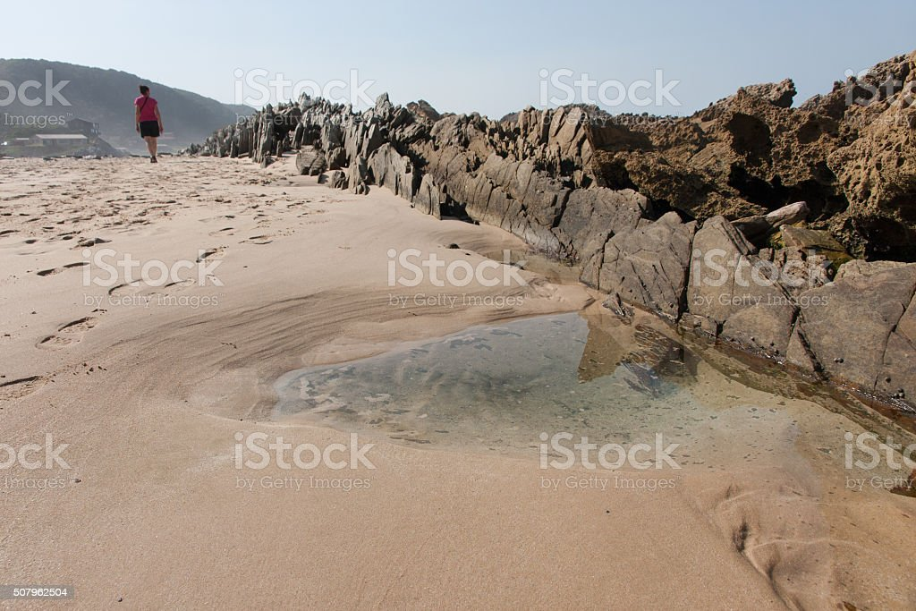Woman at Eersterivier Beach in South Africa 4 stock photo