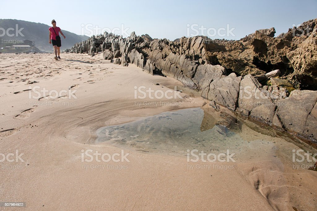 Woman at Eersterivier Beach in South Africa 5 stock photo