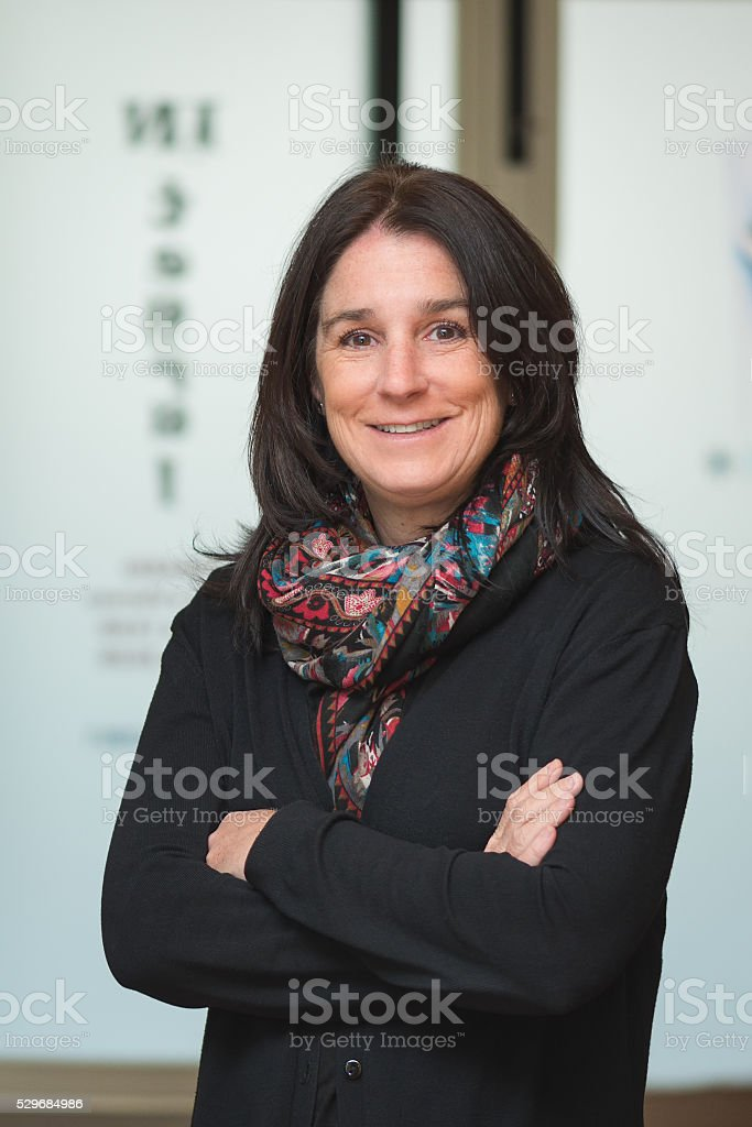 woman at entrance hall workplace standing crossing arms stock photo