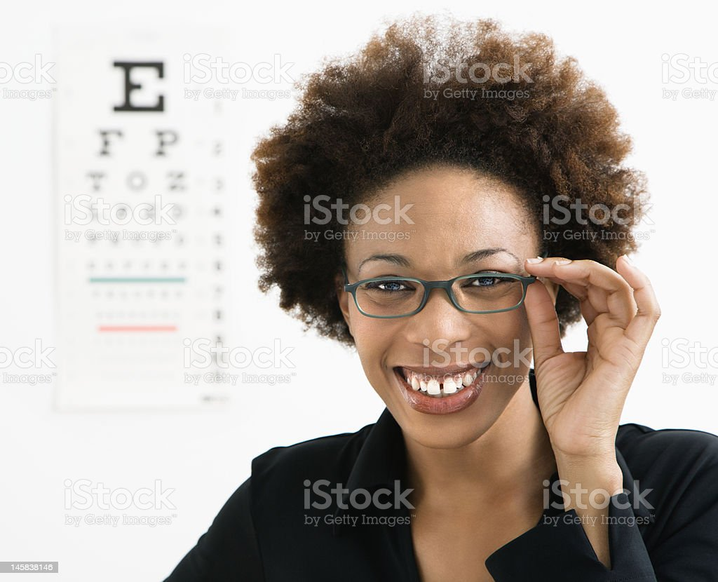 Woman at eye doctor stock photo