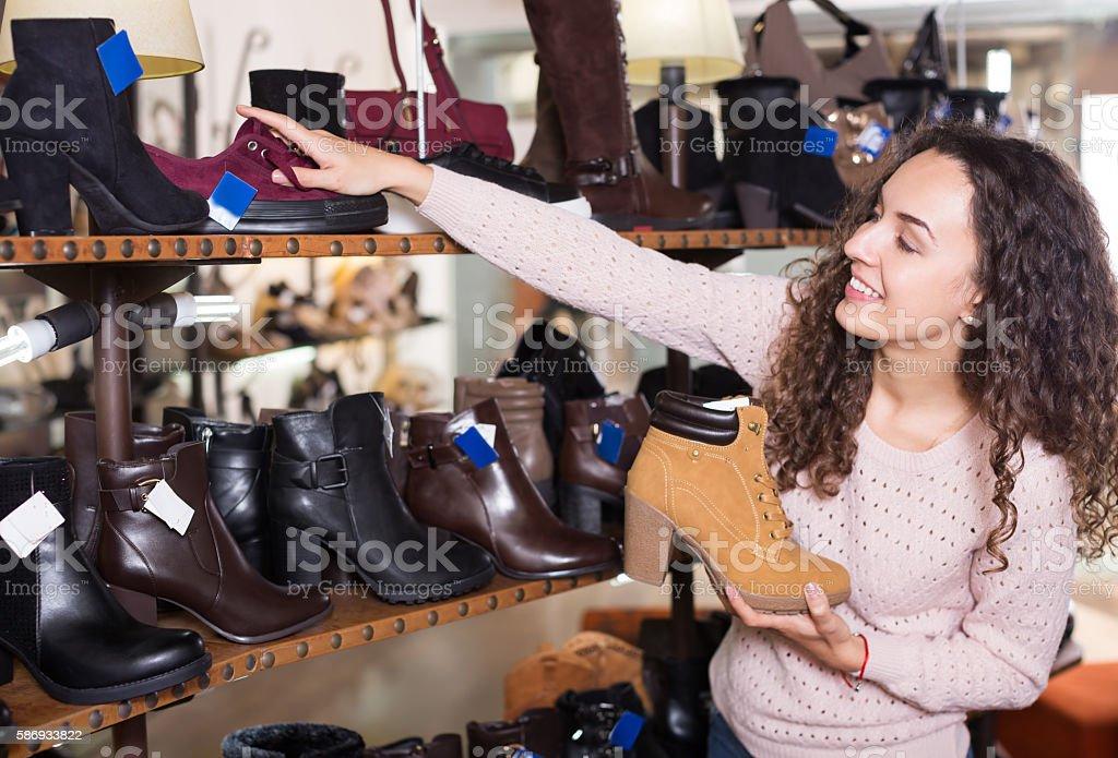 Woman at fashion shoe store stock photo