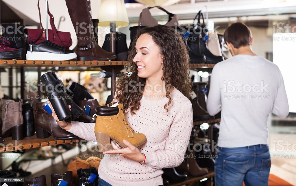 Woman at fashion shoe store stock photo