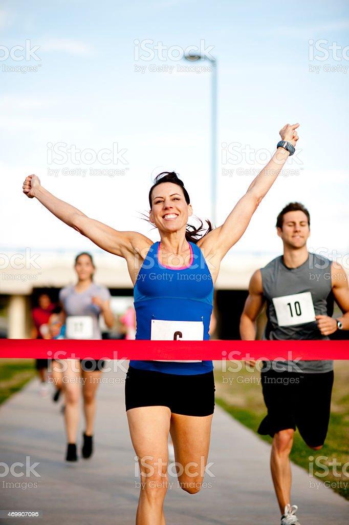 Woman at Finish Line stock photo