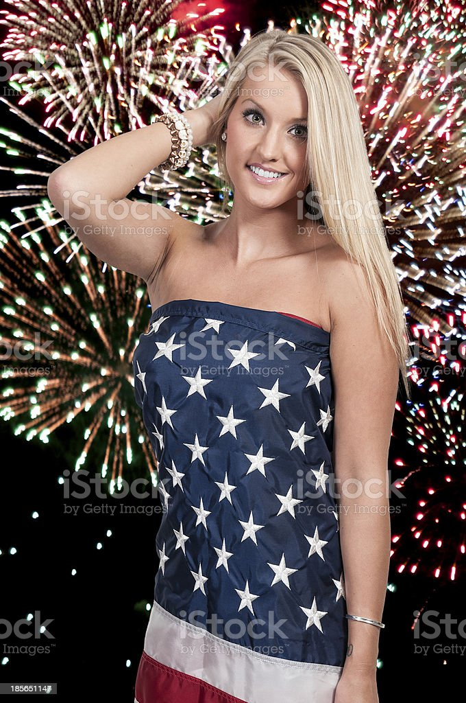 Woman at Fireworks in a Flag stock photo