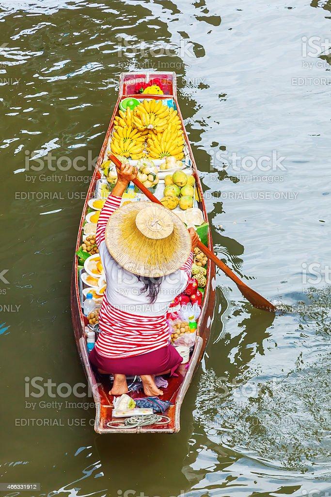 woman at floating market Damnoen Saduak in Thailand stock photo