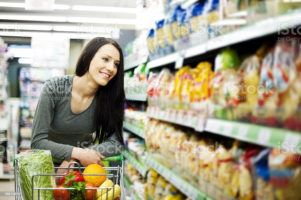 Woman at groceries store stock photo
