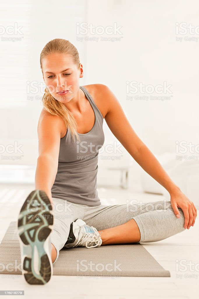 Woman at gym doing stretching exercise royalty-free stock photo
