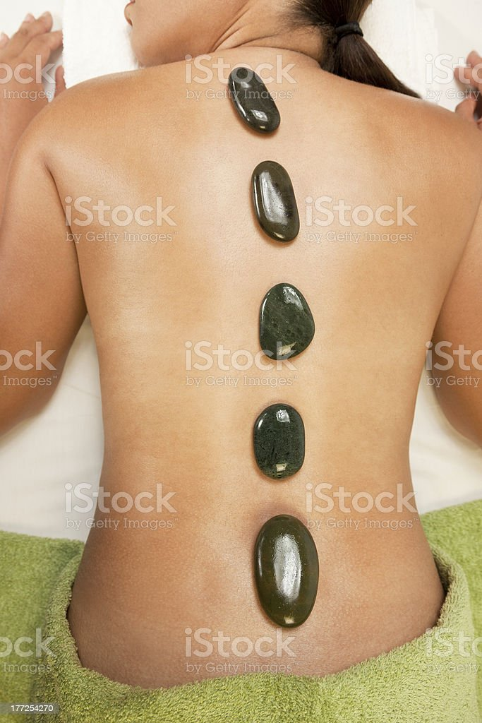 Woman at Health Spa Hot Stone Treatment Massage royalty-free stock photo