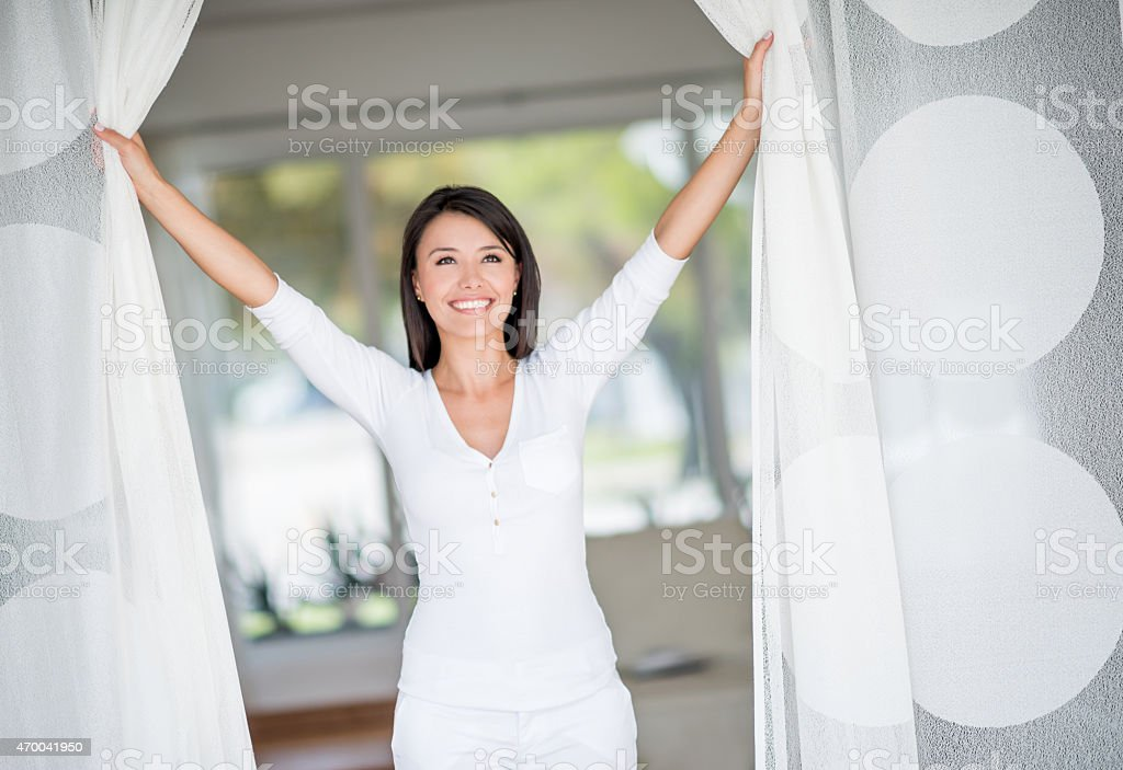 Woman at home enjoying her freedom stock photo