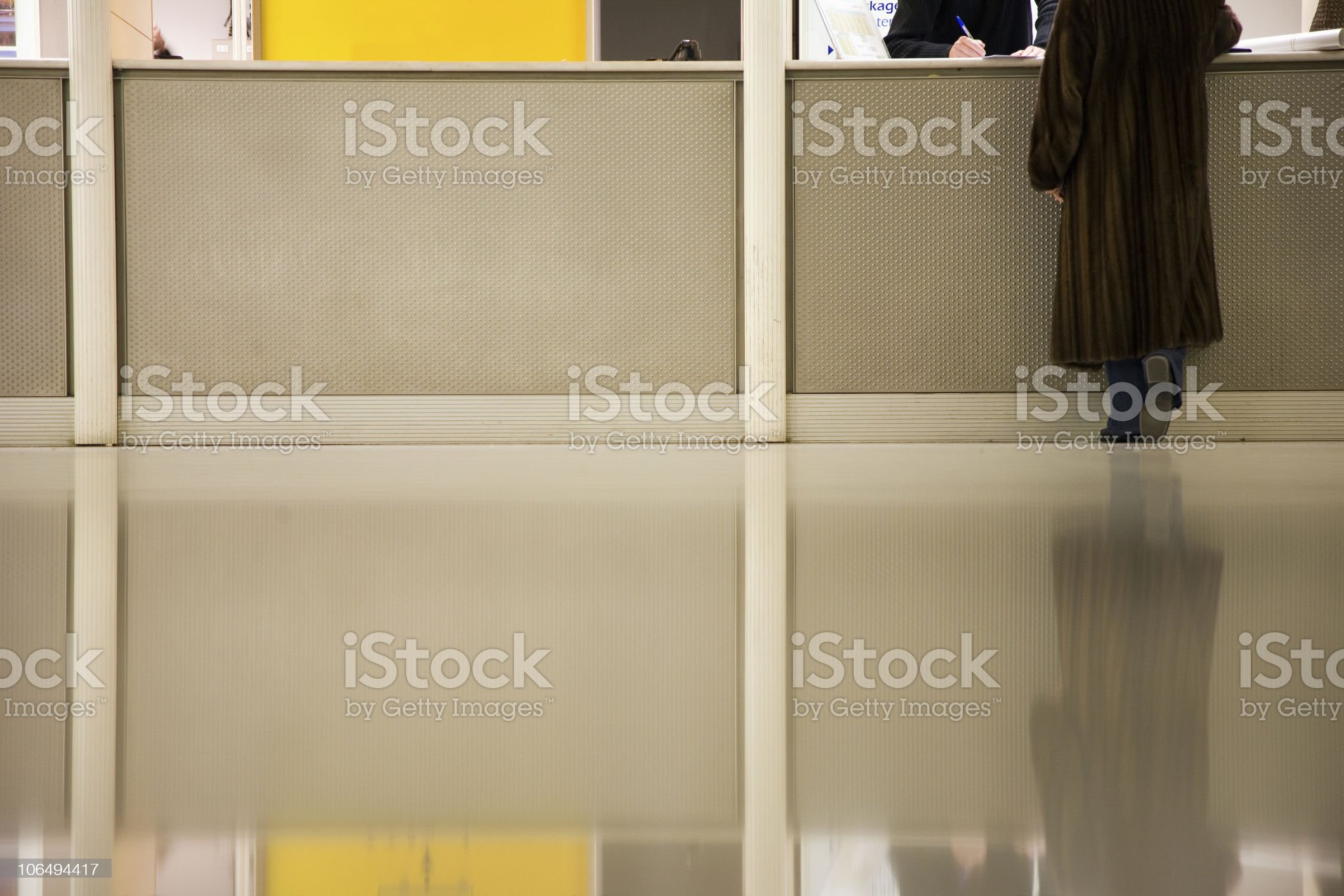 woman at info desk in Paris airport royalty-free stock photo