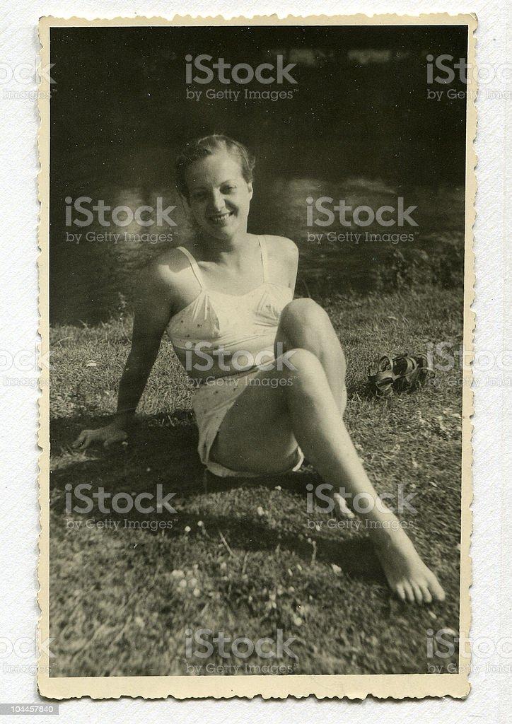 Woman at lakeside - circa 1945 stock photo