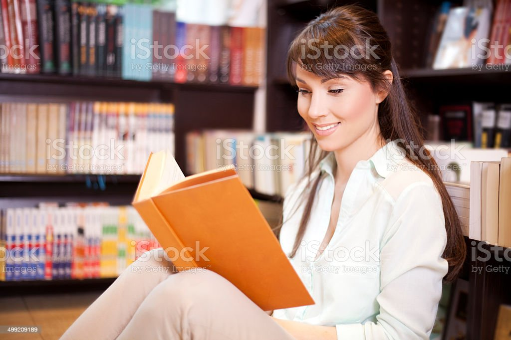 Woman at library stock photo