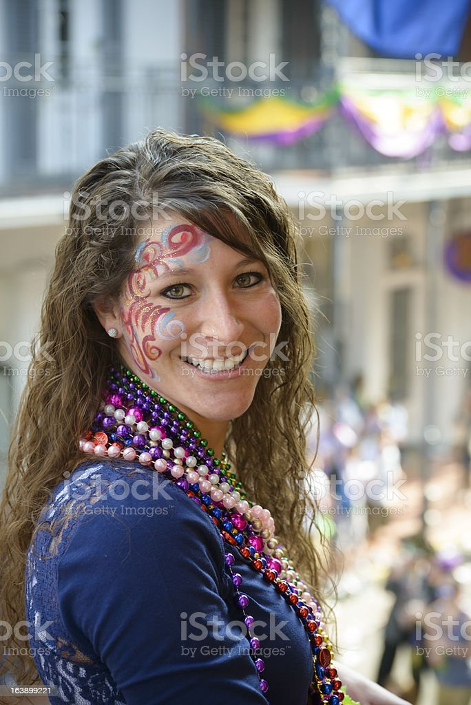 Woman at Mardi Gras with beautiful smile and wearing beads royalty-free stock photo