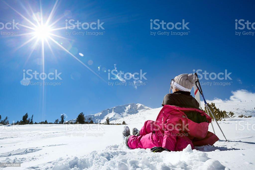 Woman at mountains enjoying in sun stock photo