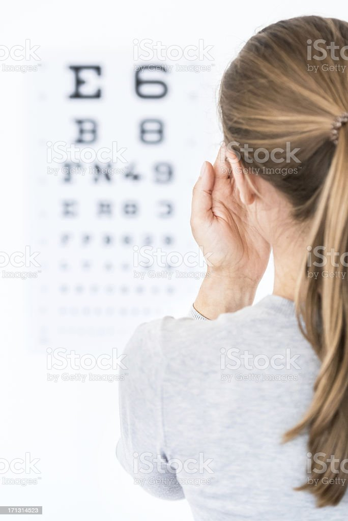 Woman at Optometrist / Eye Doctor stock photo