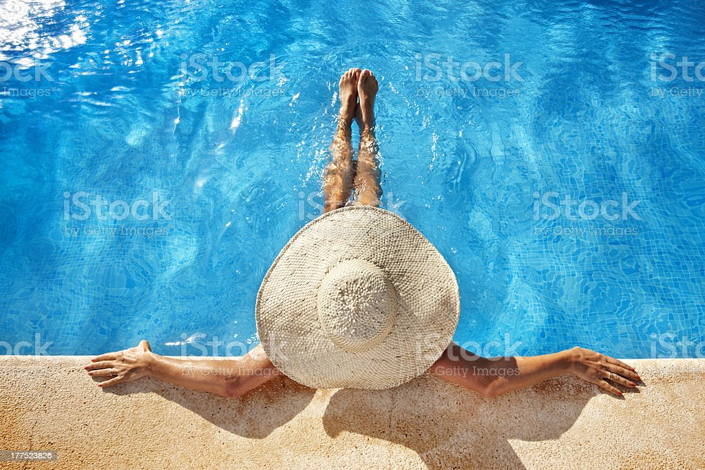 Woman at poolside stock photo