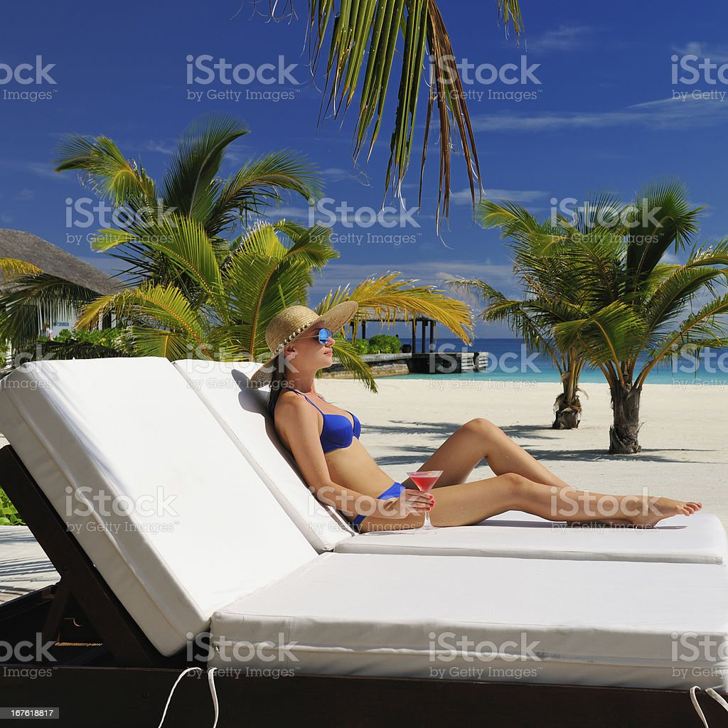Woman at poolside with cosmopolitan cocktail royalty-free stock photo