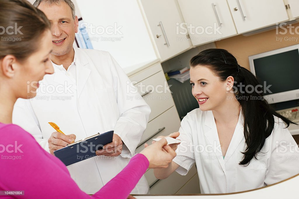 Woman at reception of clinic royalty-free stock photo