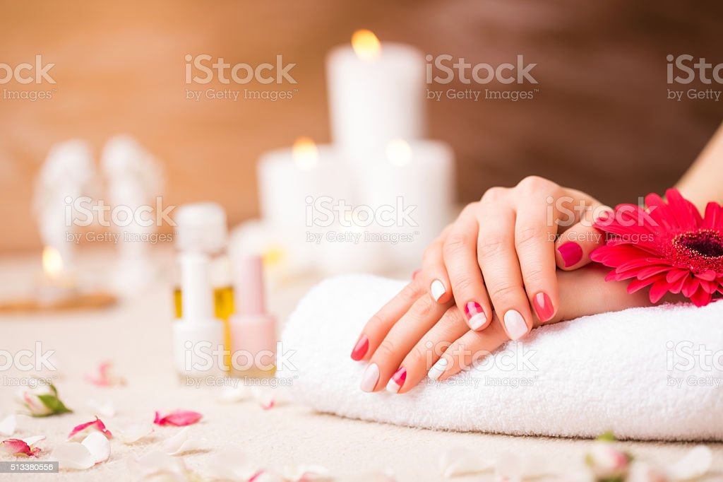 Woman at saloon with pretty manicure stock photo