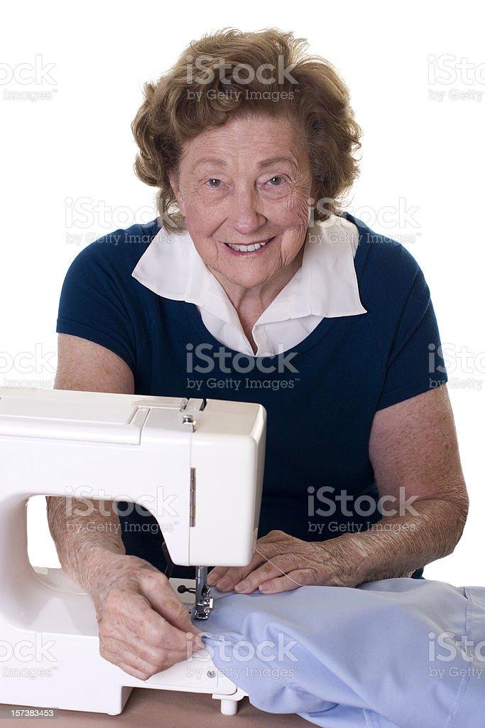 Woman at sewing machine stock photo