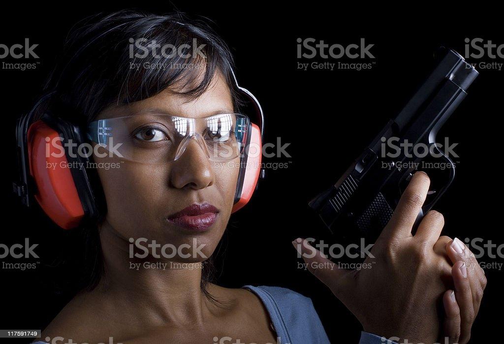 Woman at shooting range royalty-free stock photo