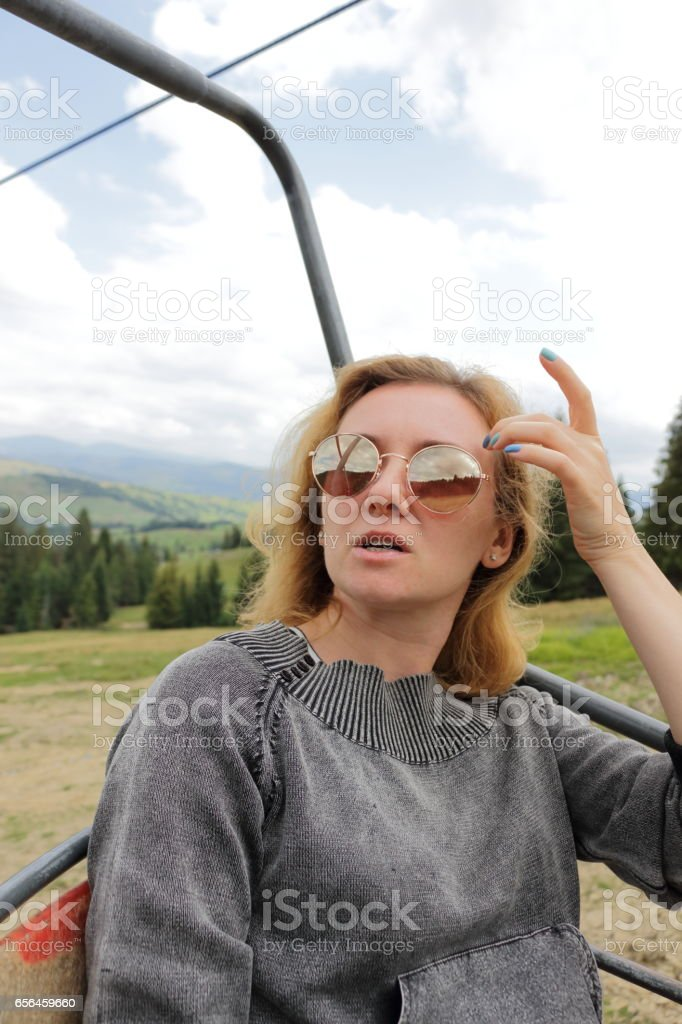 Woman at  ski lift. stock photo