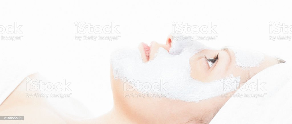 Woman at spa center with face mask on stock photo