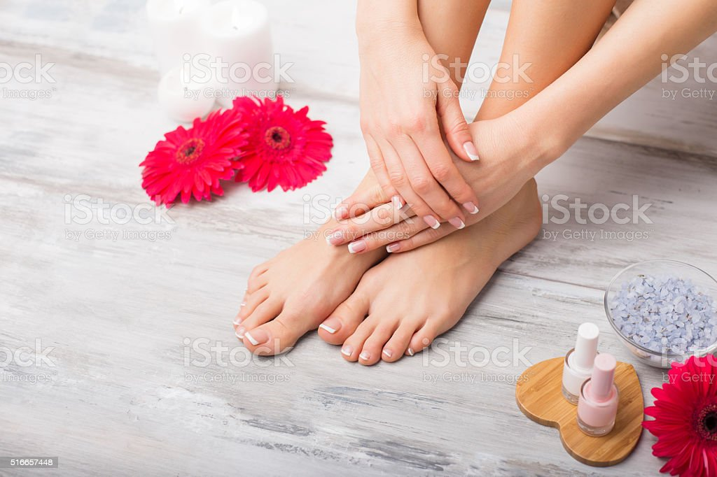 Woman at spa doing manicure and pedicure stock photo
