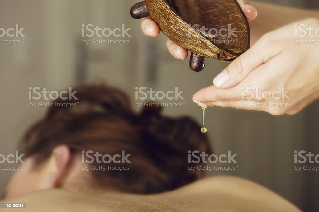 Woman at spa on a massage table stock photo