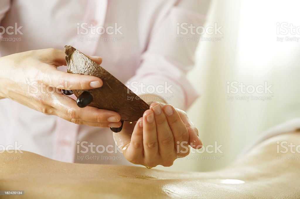 Woman at spa on a massage table royalty-free stock photo