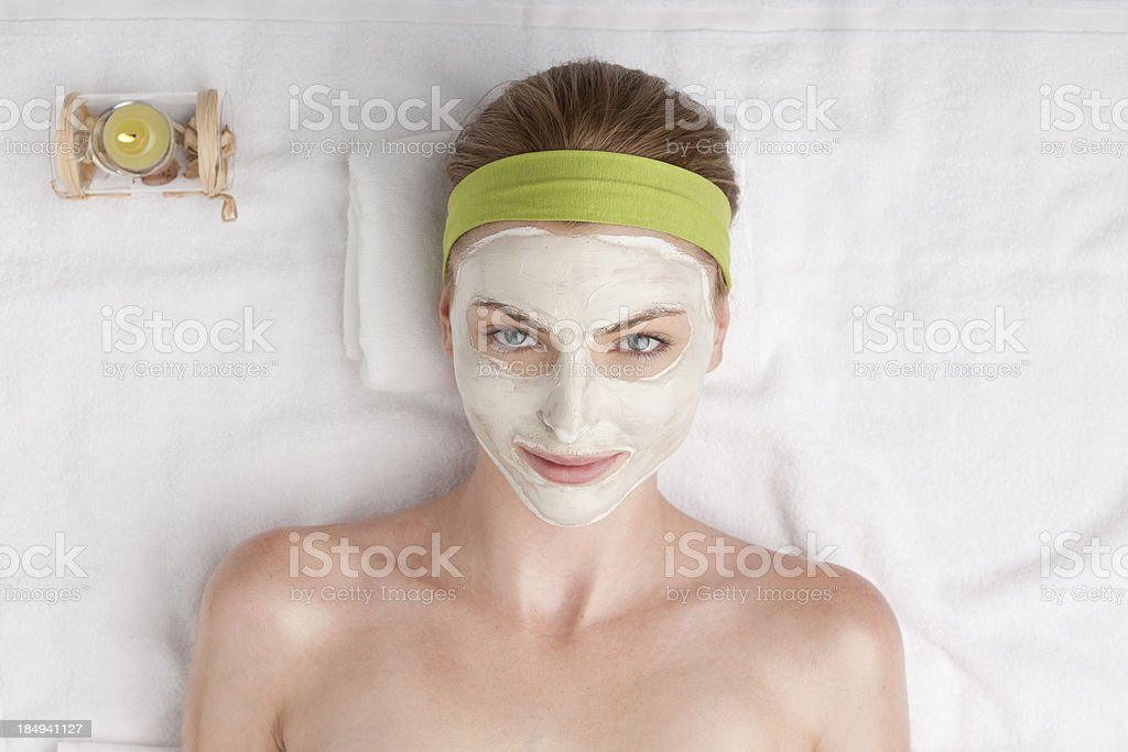 woman at spa with cosmetic facial mask royalty-free stock photo