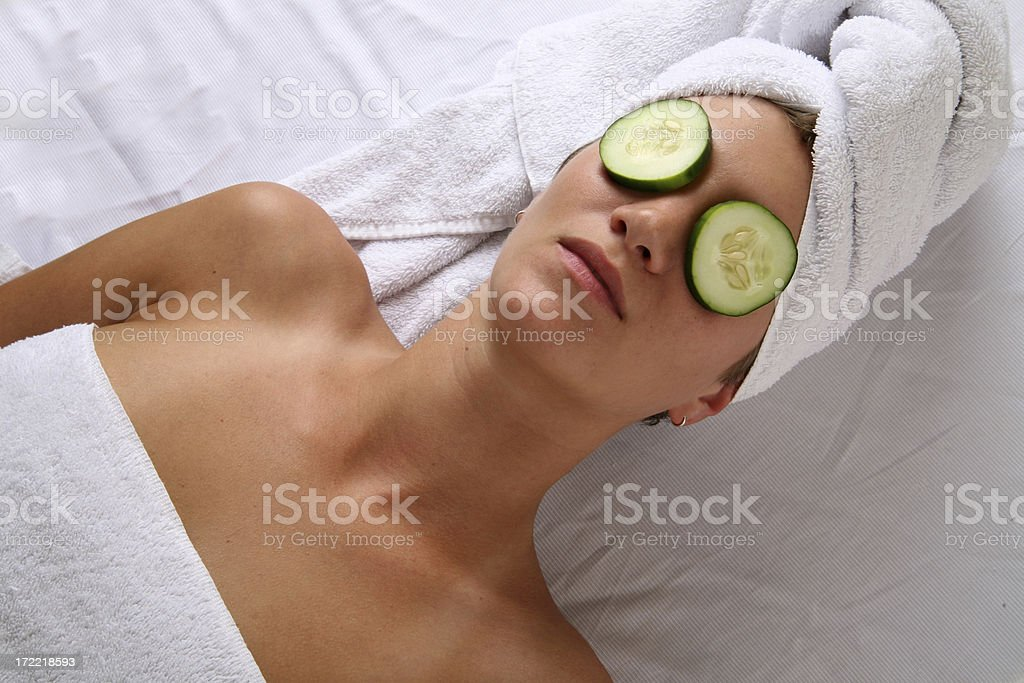 Woman at spa with cucumber royalty-free stock photo