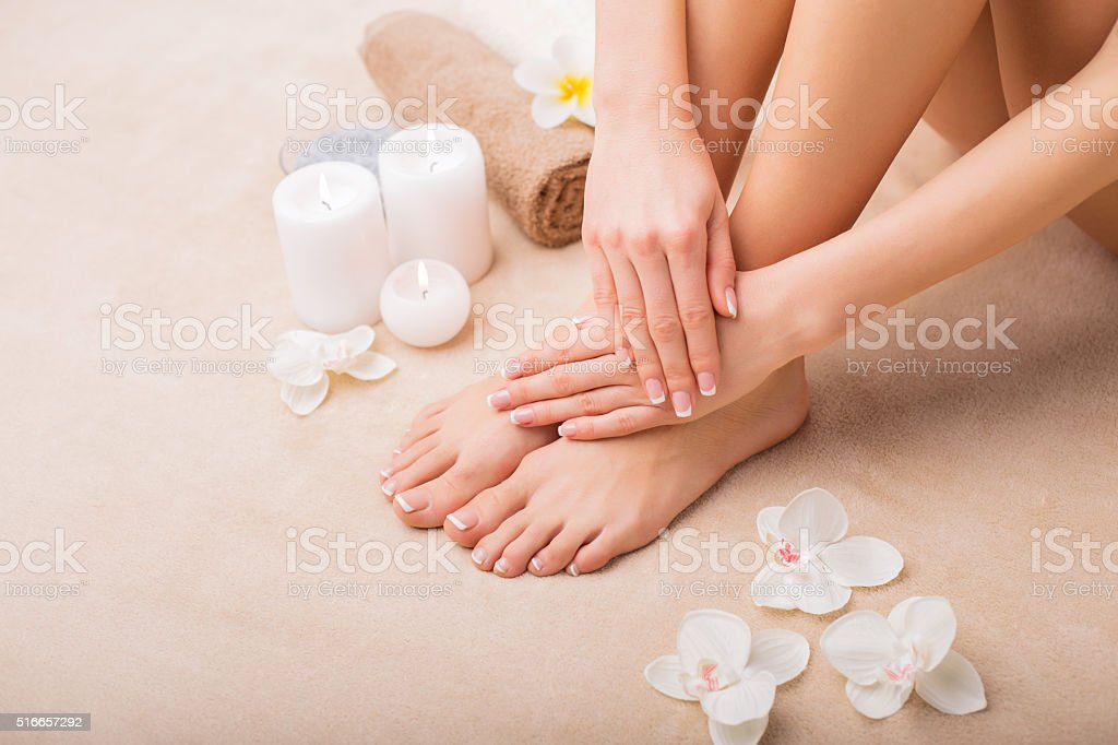 Woman at spa with done manicure and pedicure royalty-free stock photo
