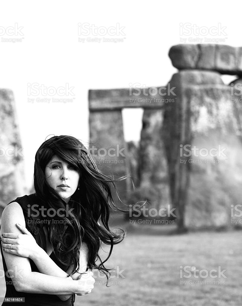 Woman at Stonehenge in Black and White royalty-free stock photo