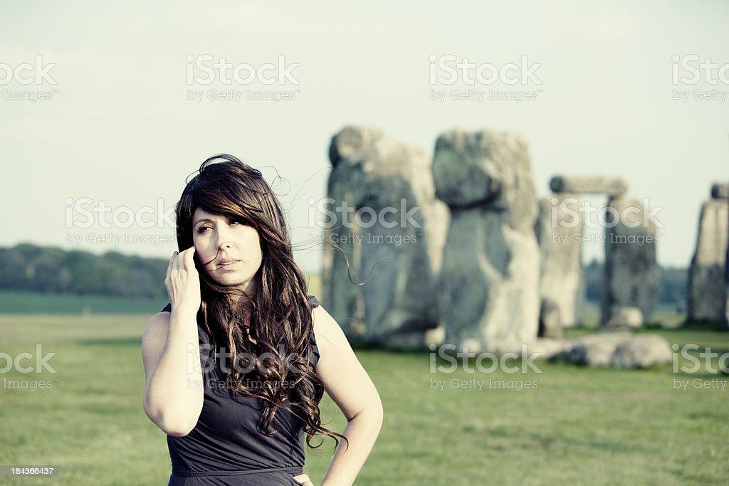 Woman at Stonehenge Side Gaze royalty-free stock photo