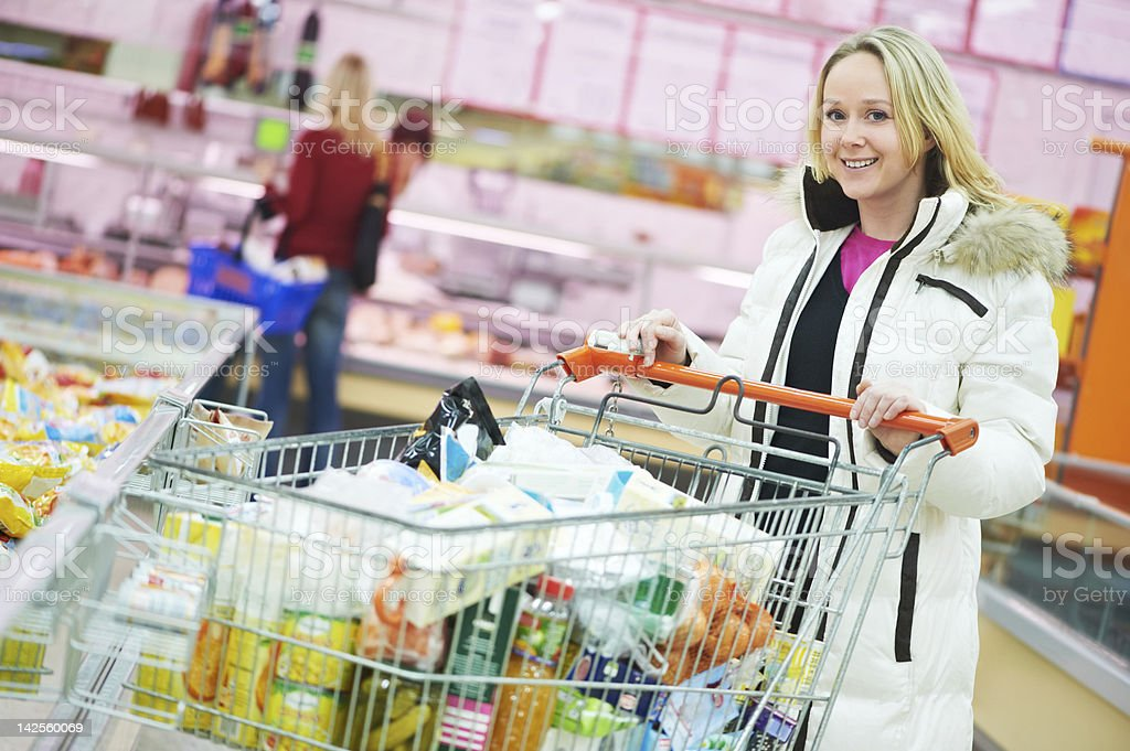 woman at supermarket dairy shopping royalty-free stock photo