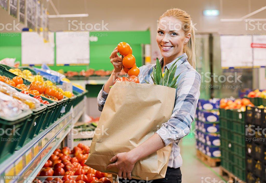 Woman at supermarket royalty-free stock photo