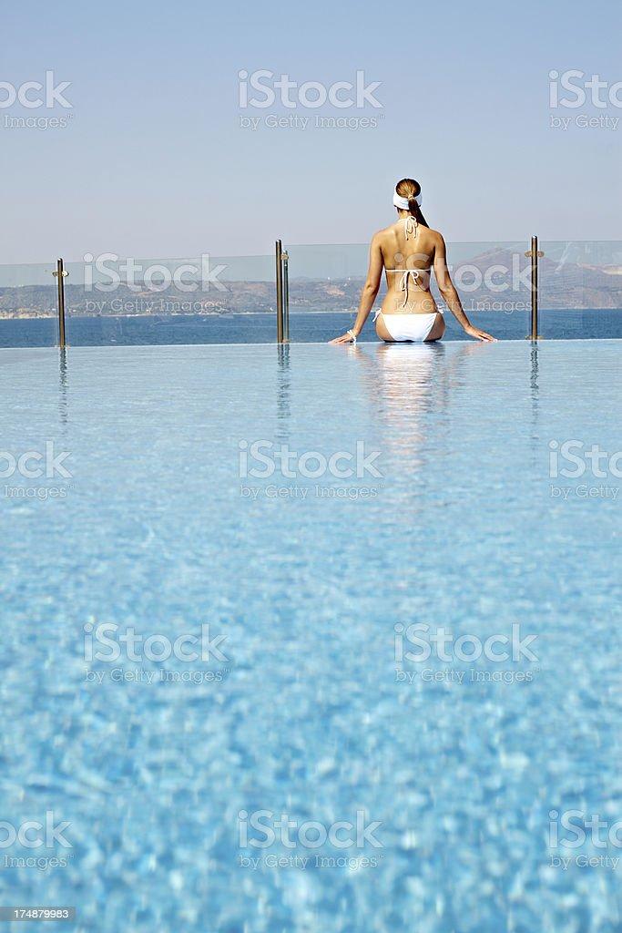 Woman at swimming pool royalty-free stock photo