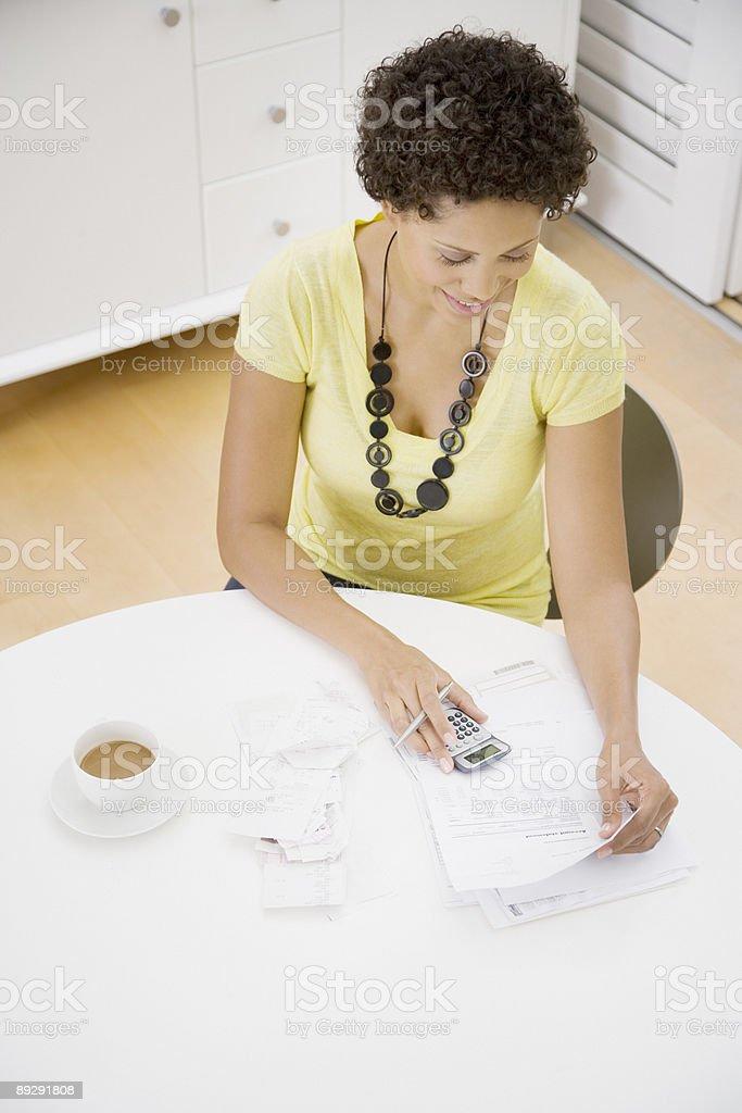 Woman at table paying bills royalty-free stock photo