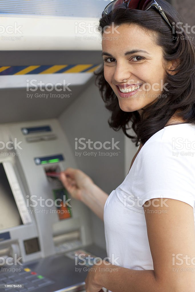 Woman at the ATM royalty-free stock photo