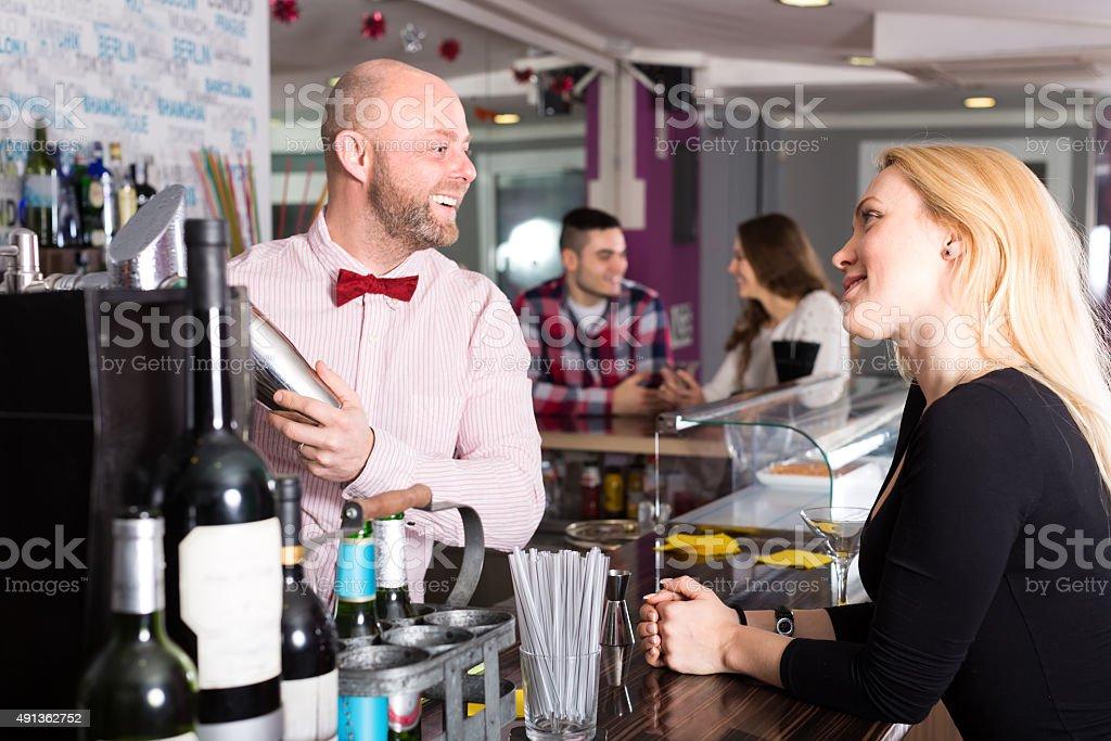 Woman at the bar stock photo