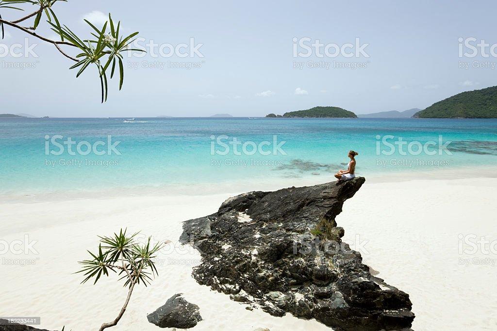 woman at the beach meditating royalty-free stock photo