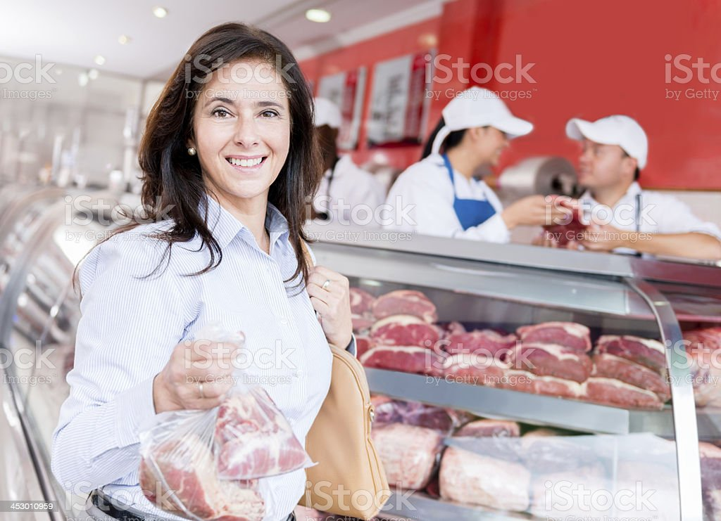 Woman at the butchers royalty-free stock photo