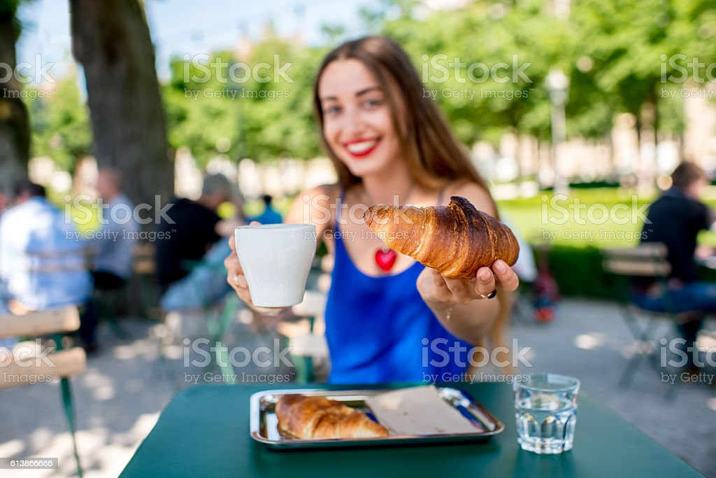 Woman at the cafe outdoors stock photo
