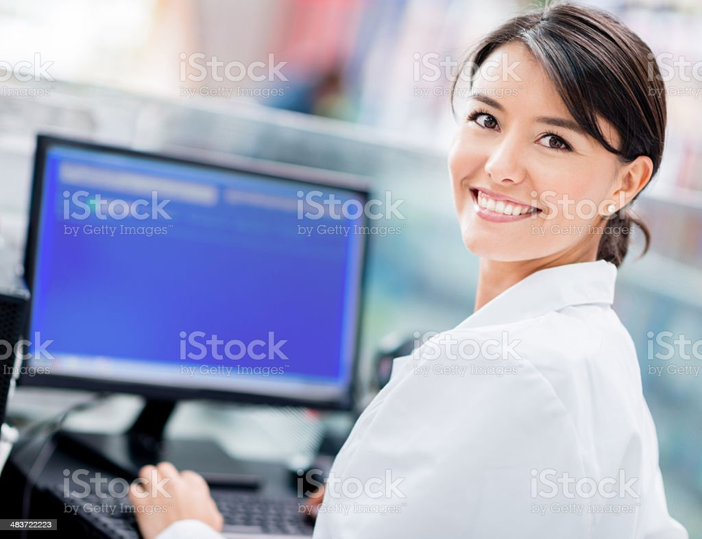 Woman at the checkout counter stock photo