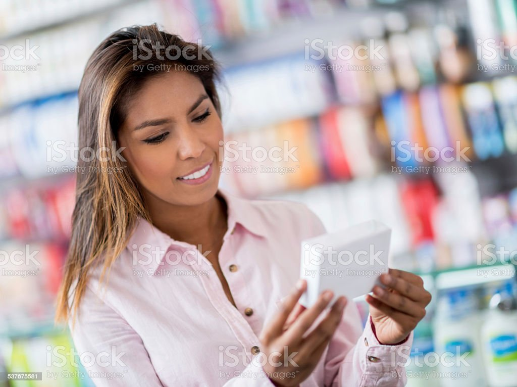 Woman at the drugstore buying medicine stock photo