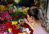Woman at the florist taking a picture
